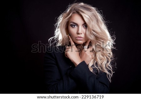 girl in black with blond hair