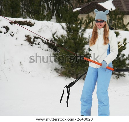 Girl in blue clothing on lift