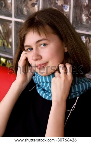 Girl in Blue Scarf Listening Music