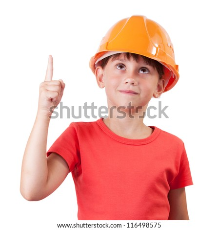 Girl in building helmet shows thumb up