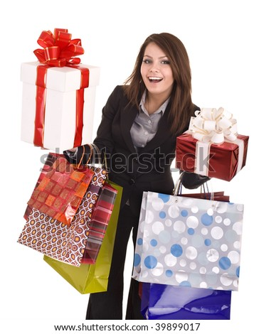 Girl in business suit with group  gift box and  bag.  Isolated. - stock photo