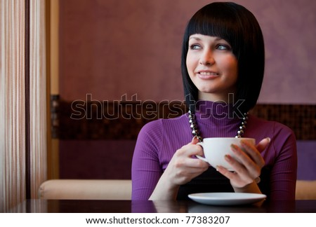 girl in cafe look at window
