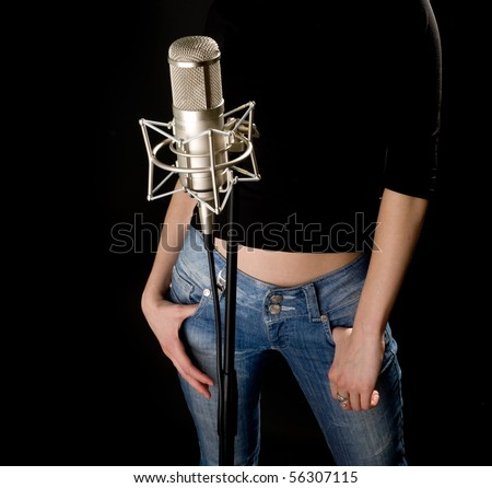 Girl in cap with studio microphone