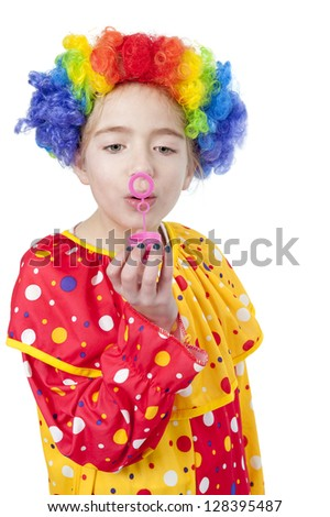 girl in clown costume blowing air bubbles, isolated on white background