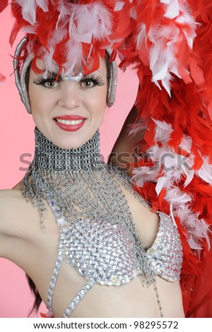 Girl in colorful carnival costumes on colored background