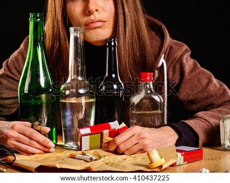 Girl in depression drinking alcohol. Drinking habits.
