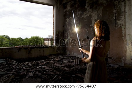 Stock Photo Girl in dress with sword