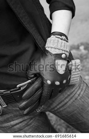 Girl in fashionable leather gloves. Leather gloves on the hand