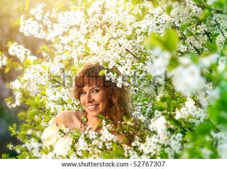 stock-photo-girl-in-flowers-52767307.jpg