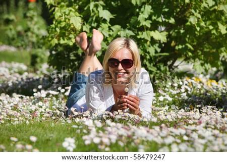 Girl in garden between flowers