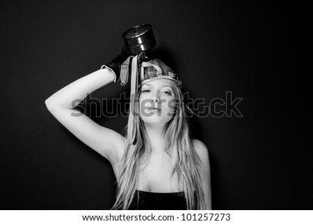 Girl in gas-mask against dark wall - stock photo