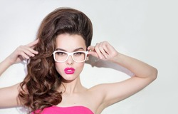 Girl in glasses on a white background