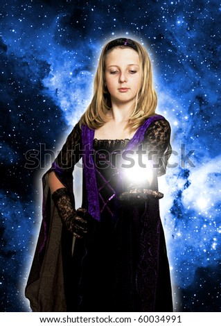 girl in gothic dress holding a light on her open hand