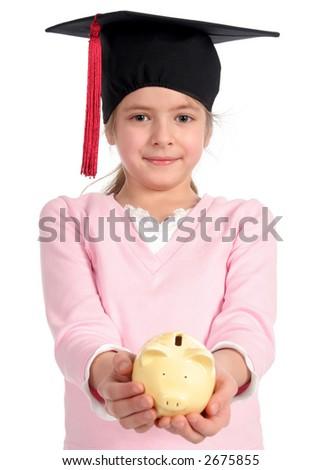 Girl in graduation cap holding piggy bank