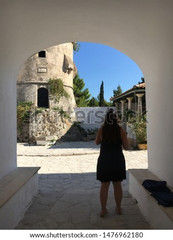 Girl in Greece. Wind Mill. Sun Historic village
