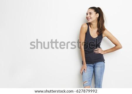 Stock Photo Girl in grey vest, looking away