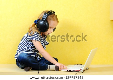 girl in headphones with a laptop