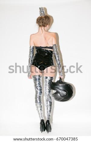 Stock Photo Girl in helmet and futuristic costume, crank