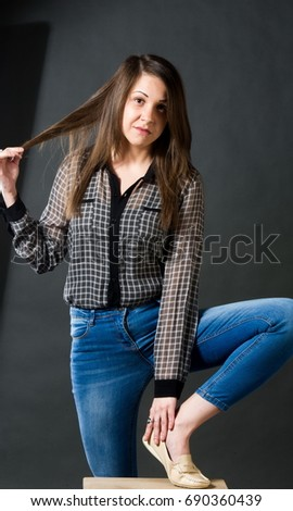 Girl In Jeans And A Plaid Shirt Brunette With Hairstyle In The