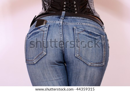 Girl in jeans from behind with cell phone in her pocket