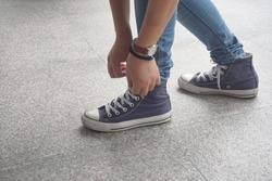 Girl in jeans wearing sneakers close up,Selective focus