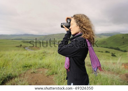 girl in landscape with camera. Natal midlands, kwazulu-Natal, South Africa