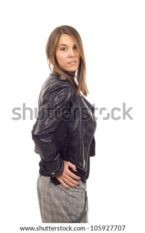 Girl in leather jacket - Young fashion model posing in a black leather jacket on white background