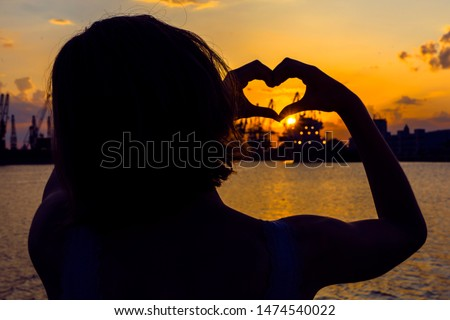 Girl in love enjoying tender moments at sunset during holiday with best friends. Emotional concept of happy exclusive lifestyle moment, sharing time, relaxing with nature contact. #1474540022