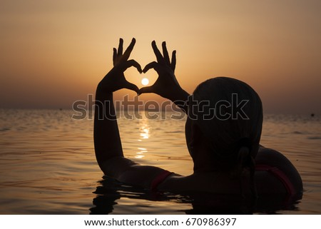 Girl in love enjoying tender moments at sunset during holiday with best friends. Emotional concept of happy exclusive lifestyle moment, sharing time, relaxing with nature contact.. #670986397