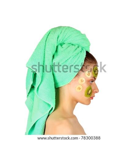 Girl in mask with kiwi - stock photo