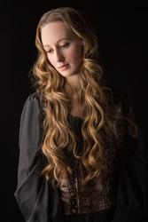 Girl in medieval black dress. Warrior girl. Medieval Female Warrior.