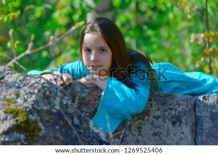 Girl in medieval dress in a fairy forest