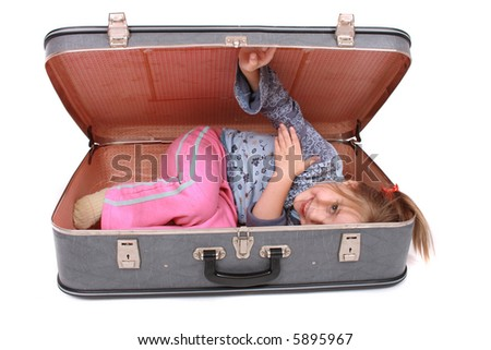 girl in old baggage - stock photo