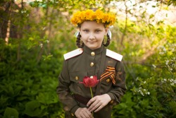 Girl in old military uniform. Background