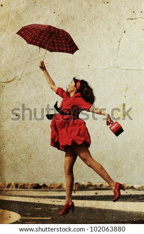 girl in red dress flies on a date. Photo in old image style.