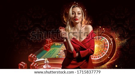Girl in red dress. Showing chips, posing on dark background. Roulette, playing table with stacks of colorful chips on it, flying dices. Poker, casino
