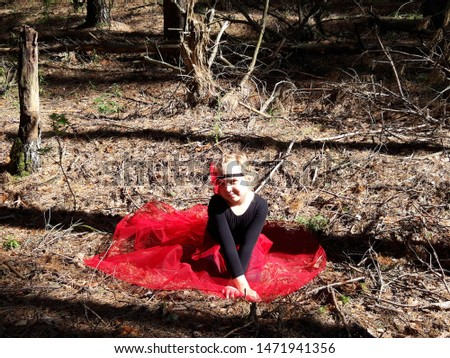 girl in red skirt and with a bandage on his head sitting on the ground in the woods in the sunshine, dancer in the woods, forest fairy, fairy tale fairy