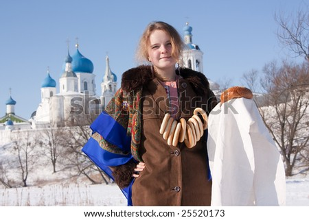 girl in russian traditional with loaf against  Russian landscape