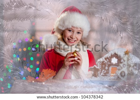 girl in Santa's hat with decoration ball in hands