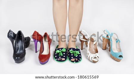 Girl in Slippers before choosing shoes