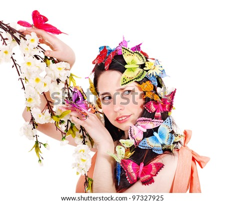 Girl in spring hairstyle and makeup holding flower.