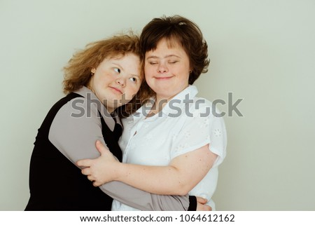 Girl in studio, She's my precious treasure. girls with down syndrome #1064612162