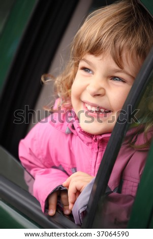 girl in the car looking throw window