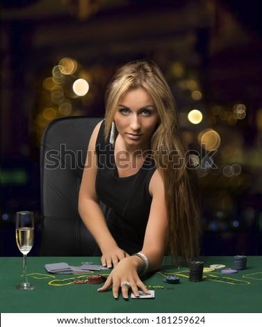 girl in the casino playing poker, bokeh