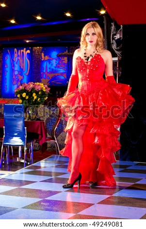 Girl in the clothes of past years in style Cabaret Moulin Rouge