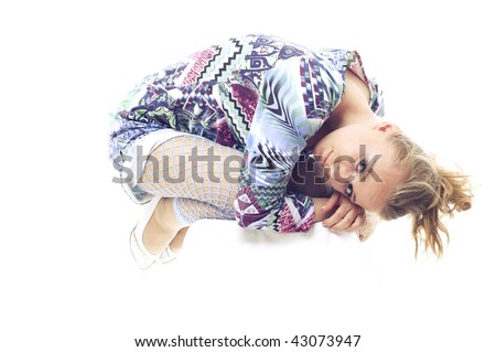 girl in the fetal position. on a white background