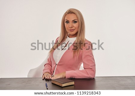 girl in the jacket at the table                #1139218343