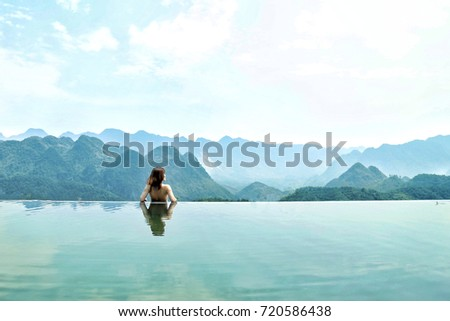 Shutterstock girl in the overflowing pool, natural bath tub