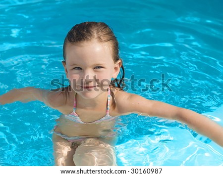 girl in the swimming pool smiling