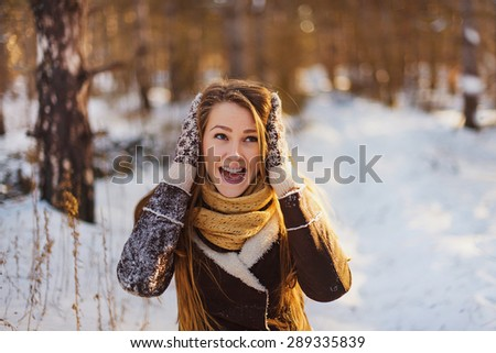 Girl in the winter forest surprised